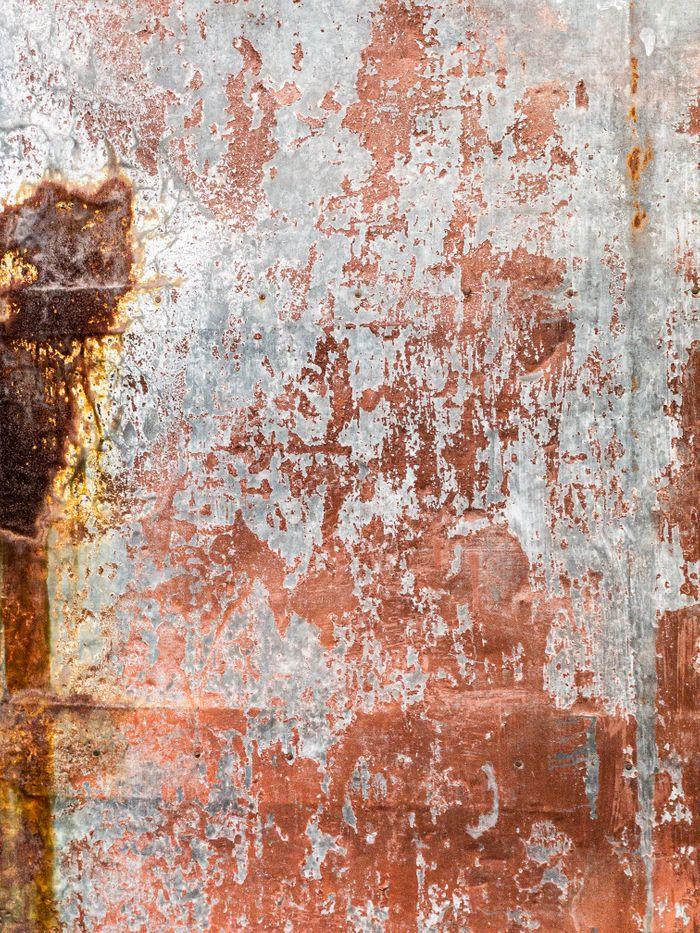 塗装が剥げた錆び付く鉄板のテクスチャの写真