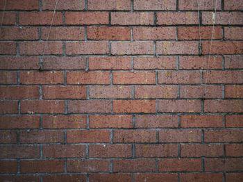 赤茶色のレンガの壁(テクスチャ)の写真