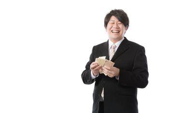 秒速で札束をカウントする銀行職員の写真