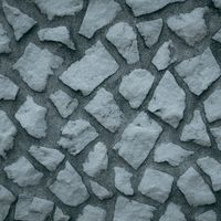 乱雑に組み込まれた石の壁(テクスチャ)の写真