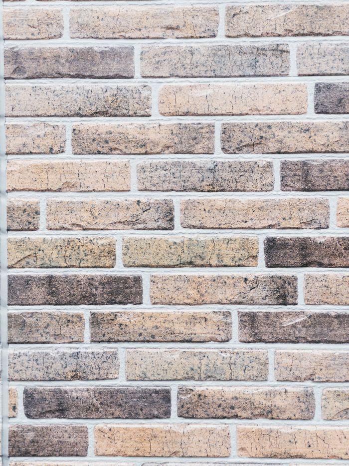 薄色のレンガ壁のテクスチャの写真
